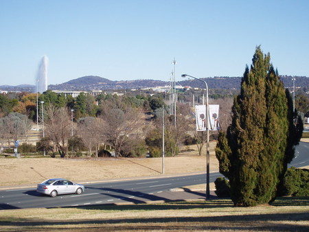 From City Hill with the Captain Cook fountain to the left, New Parliament House in the middle and Commonwealth Avenue running down the right