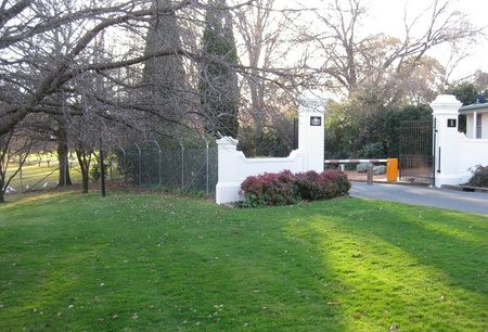 View of some of the Government House gardens from entry point on Dunrossil Drive, Yarralumla