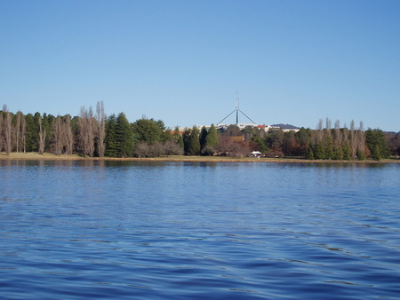 View across Lake Burley Griffin from National Museum, Acton towards Old Parliament House (obscured by trees)